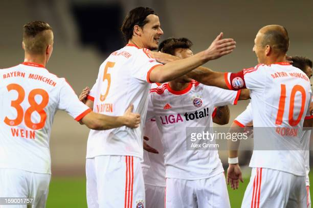 Daniel van Buyten of Muenchen celebrates his team's second goal with team mates during the international friendly match between Lekhwiya Sports Club...