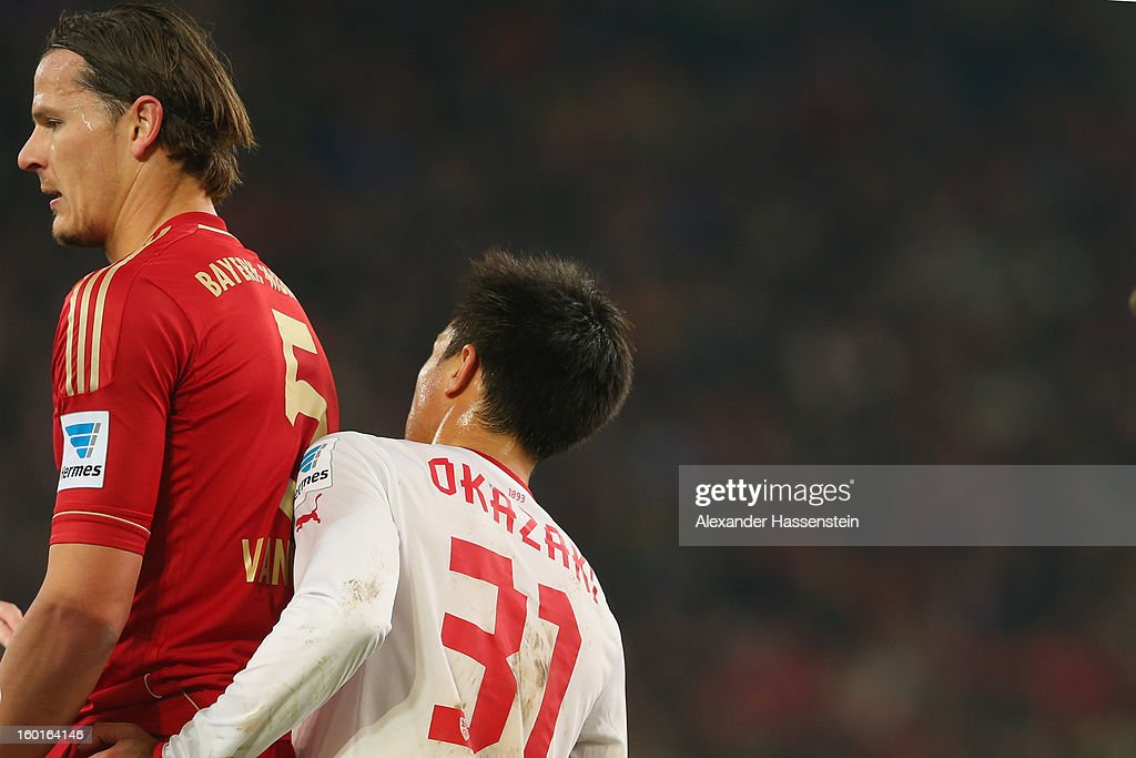 Daniel van Buyten (L) of Muenchen looks on with Shinji Okazaki of Stuttgart during the Bundesliga match between VfB Stuttgart and FC Bayern Muenchen at Mercedes-Benz Arena on January 27, 2013 in Stuttgart, Germany.
