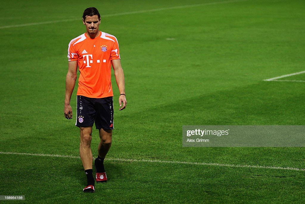 Daniel van Buyten walks over the pitch after a Bayern Muenchen training session at the ASPIRE Academy for Sports Excellence on January 4, 2013 in Doha, Qatar.