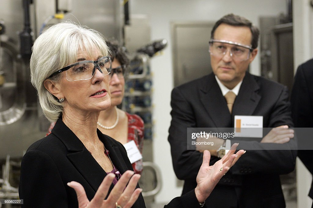 Daniel Vasella, chairman and chief executive officer of Novartis AG, right, looks on as <a gi-track='captionPersonalityLinkClicked' href=/galleries/search?phrase=Kathleen+Sebelius&family=editorial&specificpeople=700528 ng-click='$event.stopPropagation()'>Kathleen Sebelius</a>, U.S. secretary of health and human services, speaks during a tour of the new Novartis Vaccines and Diagnostics Flu Cell Culture Manufacturing Facility in Holly Springs, North Carolina, U.S., on Tuesday, Nov. 24, 2009. The facility was developed in partnership with the U.S. Department of Health and Human Services. Photographer: Jim R. Bounds/Bloomberg via Getty Images