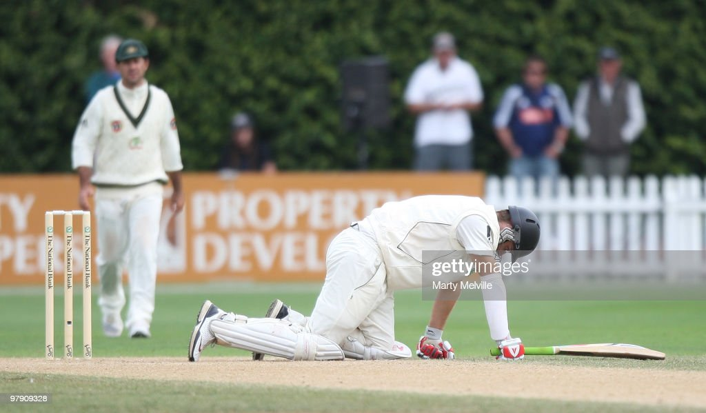 Daniel Vettori captain of New Zealand gets hit by the ball during day three of the First Test match between New Zealand and Australia at Westpac...