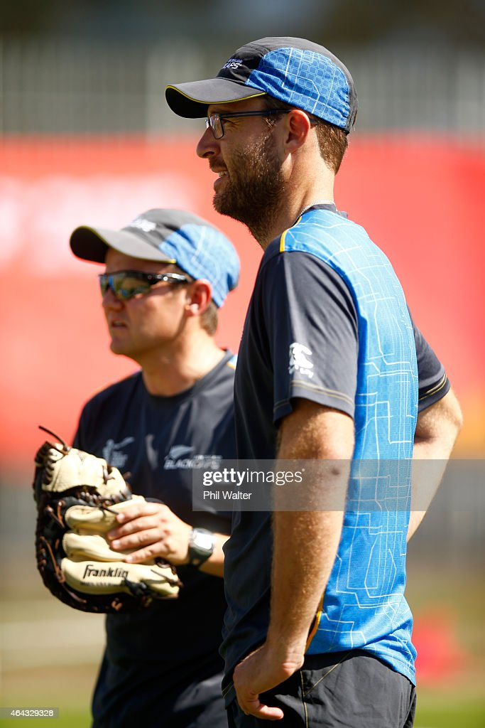 Daniel Vettori (R) chats with New Zealand coach Mike Hesson (L) during a New Zealand Black Caps training session at Eden Park on February 25, 2015 in Auckland, New Zealand.