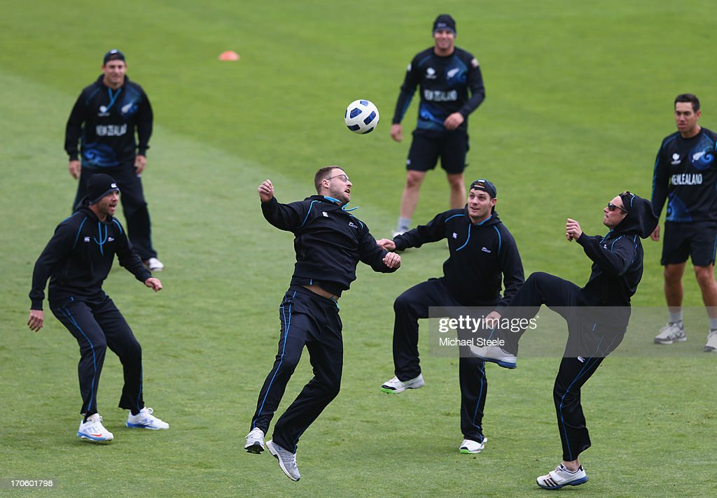 Daniel Vettori Mitchell McClenaghan and Tim Southee challnge for the ball during the New Zealnd nets session at the SWALEC Stadium on June 15 2013 in...