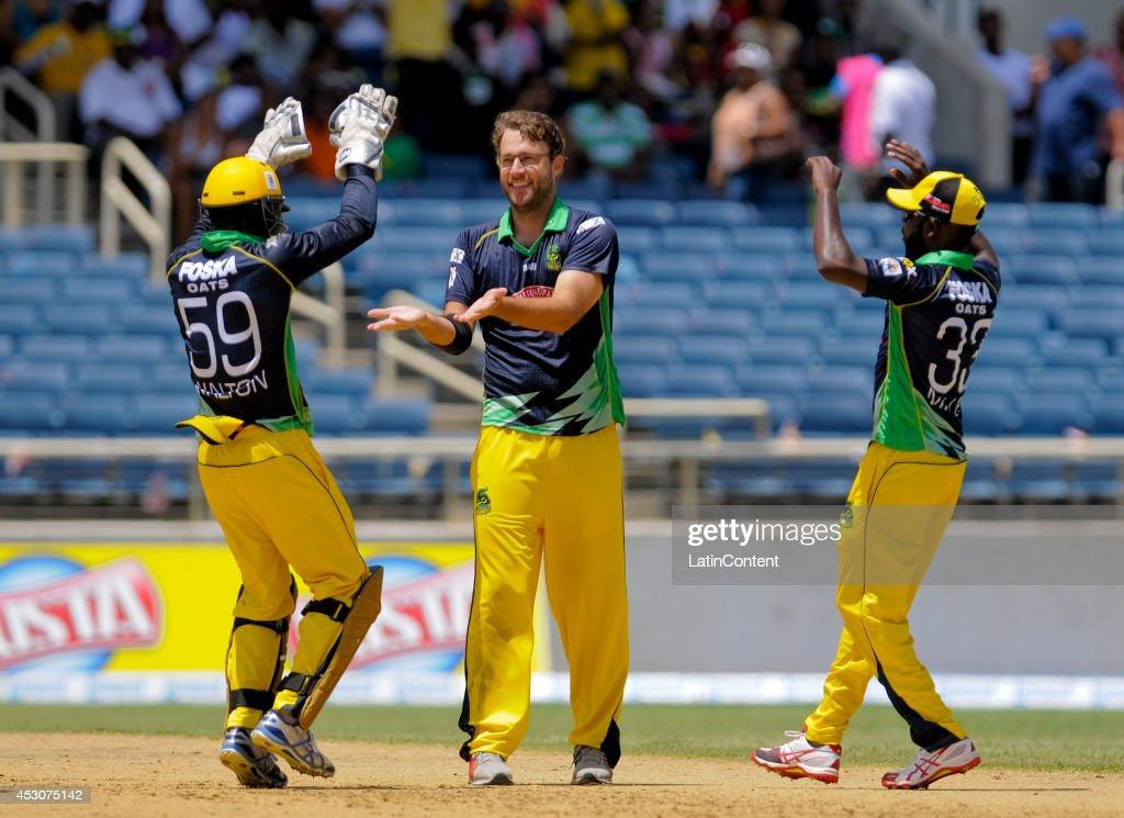 Daniel Vettori of Jamaica Tallawahs celebrates the dismissal of Martin Guptill of Guyana Amazon Warriors during a match between Jamaica Tallawahs and...