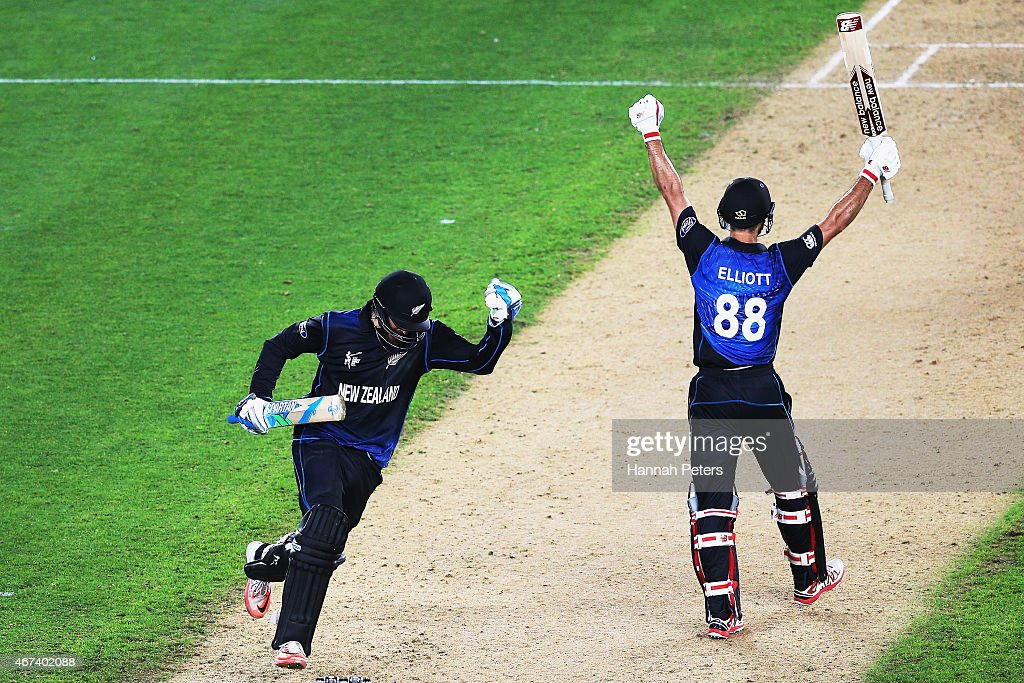 <a gi-track='captionPersonalityLinkClicked' href=/galleries/search?phrase=Daniel+Vettori&family=editorial&specificpeople=176492 ng-click='$event.stopPropagation()'>Daniel Vettori</a> of New Zealand and <a gi-track='captionPersonalityLinkClicked' href=/galleries/search?phrase=Grant+Elliott&family=editorial&specificpeople=708027 ng-click='$event.stopPropagation()'>Grant Elliott</a> of New Zealand celebrate winning the 2015 Cricket World Cup Semi Final match between New Zealand and South Africa at Eden Park on March 24, 2015 in Auckland, New Zealand.