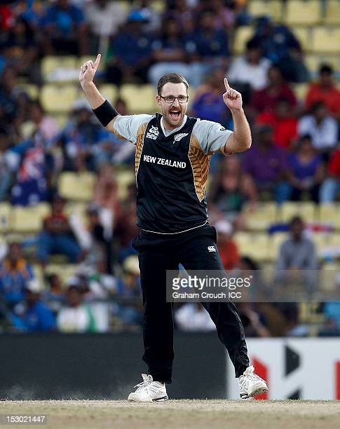 Daniel Vettori of New Zealand celebrates taking the wicket of Craig Kieswetter of England during the A1 versus B2 ICC World T20 Super Eight match...