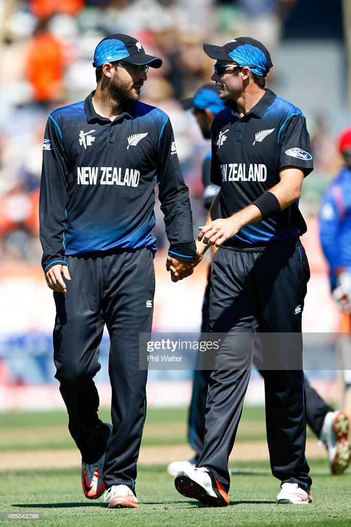 Daniel Vettori of New Zealand is congratulated by Tim Southee at the end of his bowling spell during the 2015 ICC Cricket World Cup match between New...