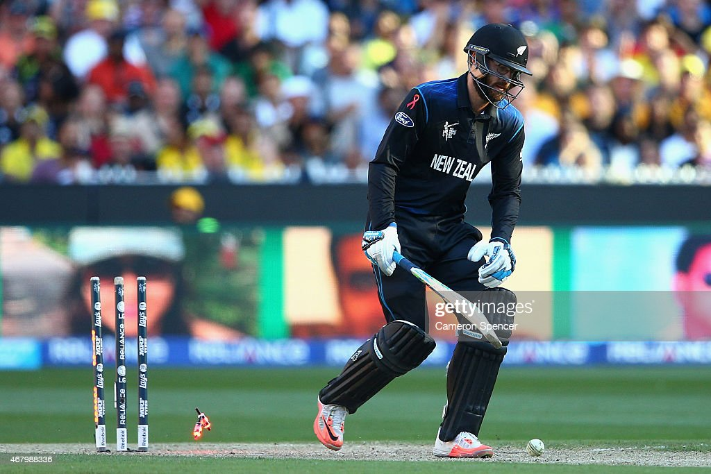 Daniel Vettori of New Zealand is dismissed by Mitchell Johnson of Australia during the 2015 ICC Cricket World Cup final match between Australia and...