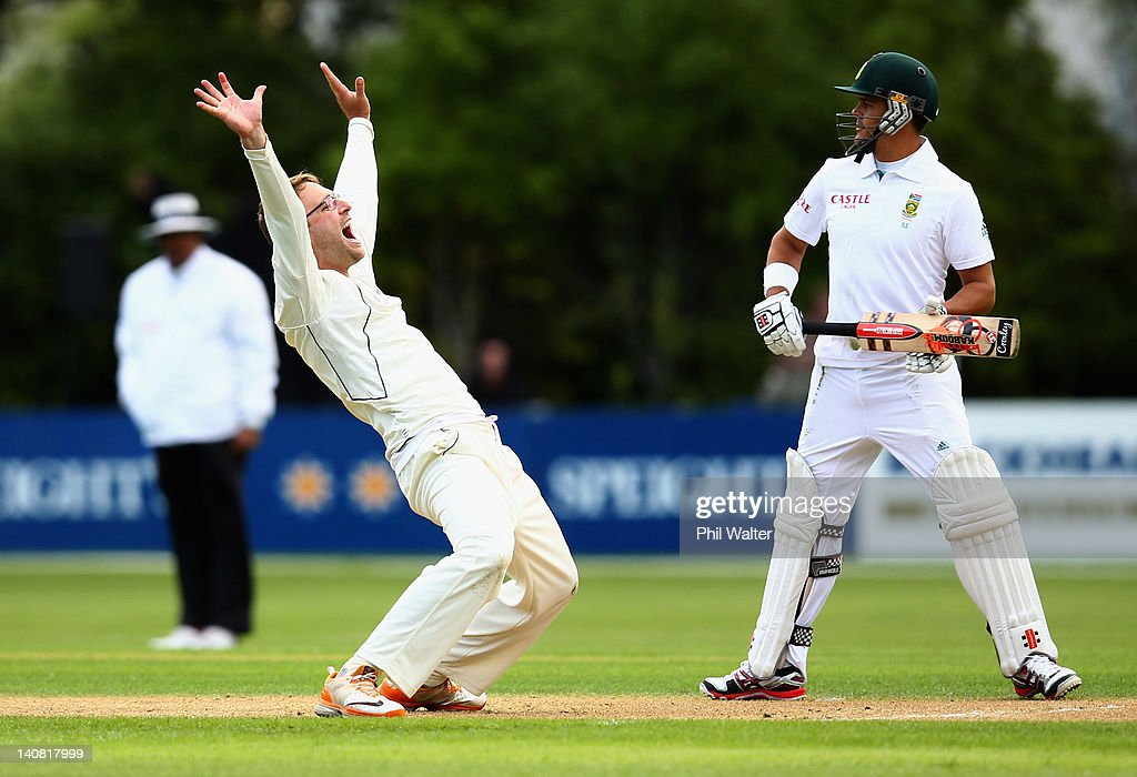 Daniel Vettori of New Zealand makes an LBW appeal as Jacques Rudolph of South Africa looks on during day one of the First Test match between New...