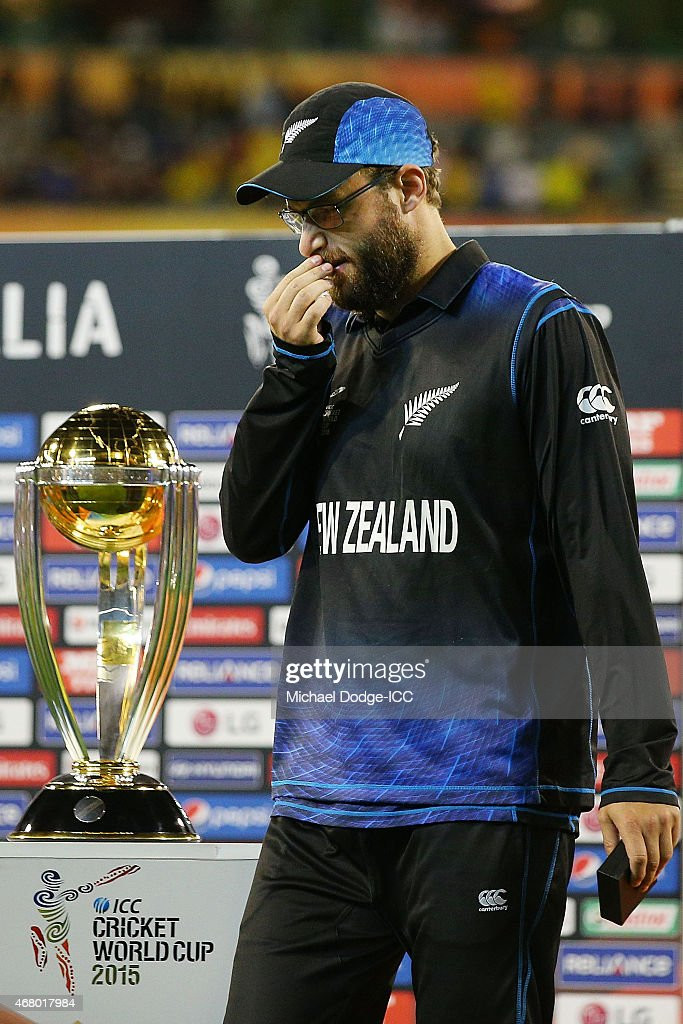 Daniel Vettori of New Zealand walks past the trophy after their defeat during the 2015 ICC Cricket World Cup final match between Australia and New...