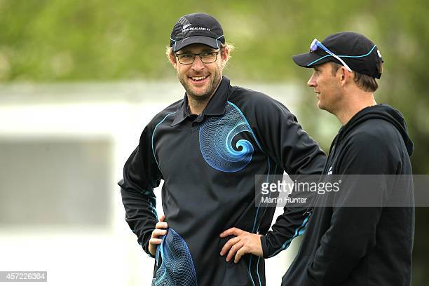 Daniel Vettori of New Zealand XI talks his bowling coach Shane Bond during the tour match between the New Zealand XI and Scotland on October 15 2014...
