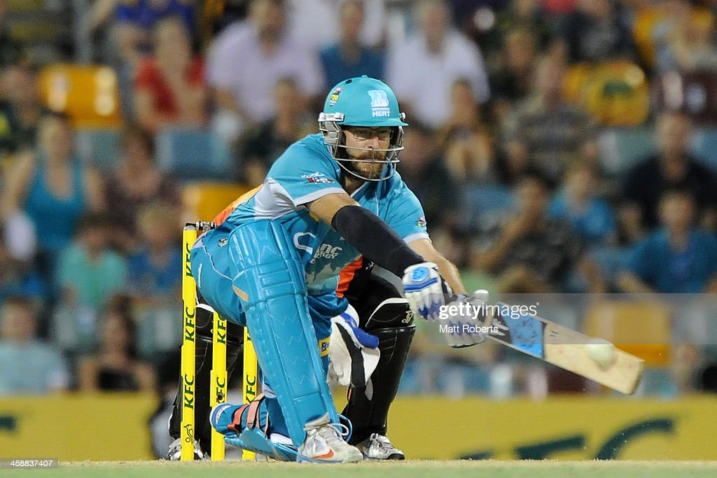 <a gi-track='captionPersonalityLinkClicked' href=/galleries/search?phrase=Daniel+Vettori&family=editorial&specificpeople=176492 ng-click='$event.stopPropagation()'>Daniel Vettori</a> of the Heat bats during the Big Bash League match between the Brisbane Heat and the Perth Scorchers at The Gabba on December 22, 2013 in Brisbane, Australia.