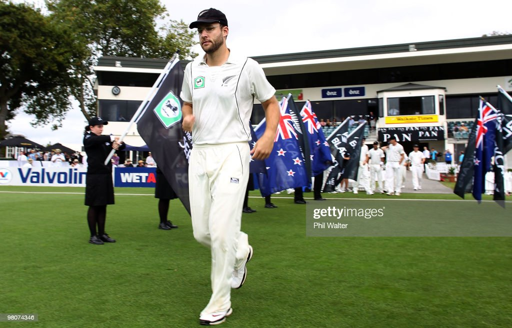 Daniel Vettori playing his 100th test match for New Zealand leads his side out for day one of the Second Test match between New Zealand and Australia...