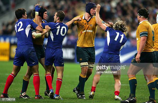 Daniel Vickerman of Australia punches Cedric Heymans of France during the Test Match between France and Australia at the Stade de France on November...