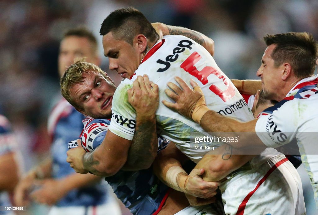 Daniel Vidot of the Dragons is tackled by Jake Friend of the Roosters during the round seven NRL match between the Sydney Roosters and the St George Illawarra Dragons at Allianz Stadium on April 25, 2013 in Sydney, Australia.