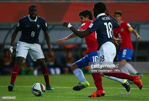 Daniel Villegas of Costa Rica and Nanitamo Ikone of France vie for the ball during the France v Costa Rica Round of 16 FIFA U17 World Cup Chile 2015...