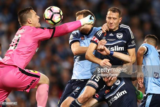Daniel Vukovic and Alex Wilkinson of Sydney competes with Besart Berisha and Alan Baro of the Victory during the 2017 ALeague Grand Final match...