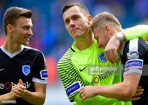 Daniel Vukovic goalkeeper of KRC Genk embraces Jakub Brabec defender of KRC Genk after the Jupiler Pro League match between KAA Gent and KRC Genk at...