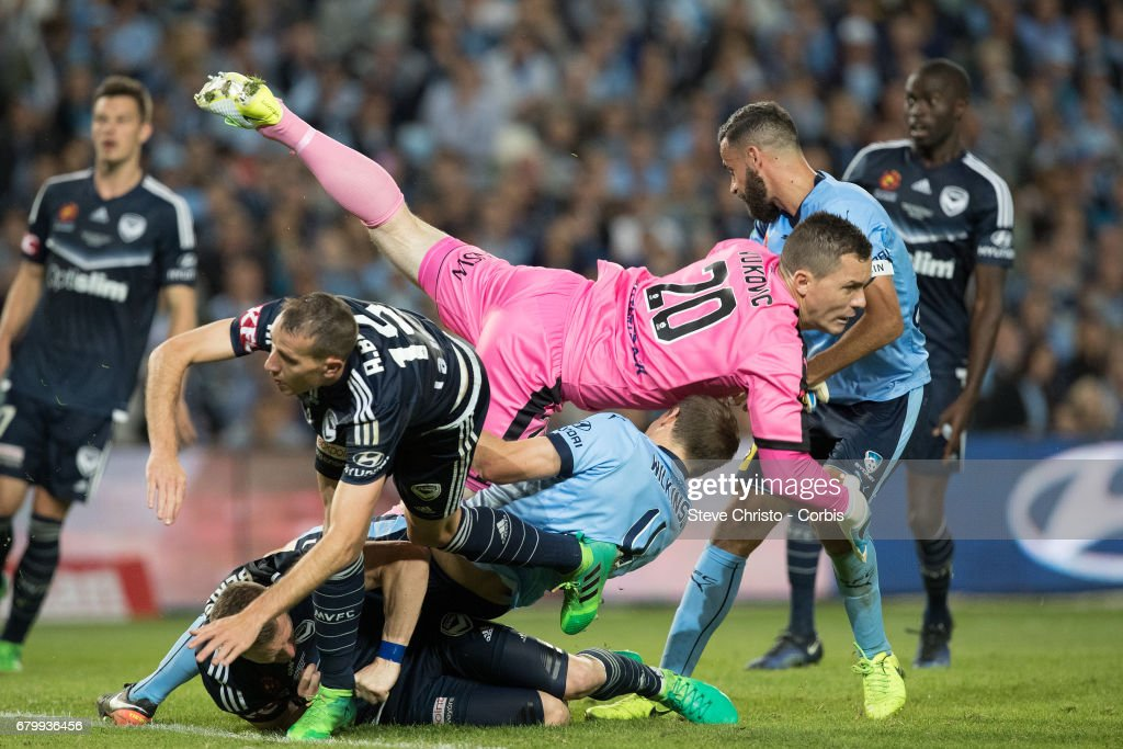 Daniel Vukovic of Sydney FC injures teammate Alexander Wilkinson during the 2017 A-League Grand Final match between Sydney FC and the Melbourne Victory at Allianz Stadium on May 7, 2017 in Sydney, Australia.