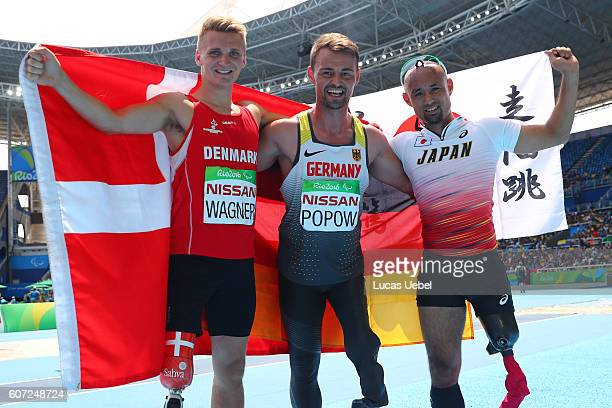 Daniel Wagner of Denmark Henry Popow of Germany and Atsushi Yamamoto of Japan celebrate after the Men's Long Jump T42 final during day 10 of the Rio...