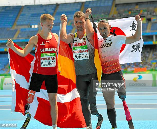 Daniel Wagner of Denmark Henry Popow of Germany and Atsushi Yamamoto of Japan celebrate their medals after the Men's Long Jump T42 final on day 10 of...