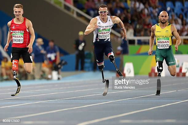 Daniel Wagner of Denmark Richard Whitehead of Great Britian and Scott Reardon of Australia competes in the Men's 100m T42 Final on day 8 of the Rio...