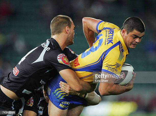 Daniel Wagon of the Eels is tackled by the Warriors defence during the round 11 NRL match between the Parramatta Eels and the Warriors at Parramatta...