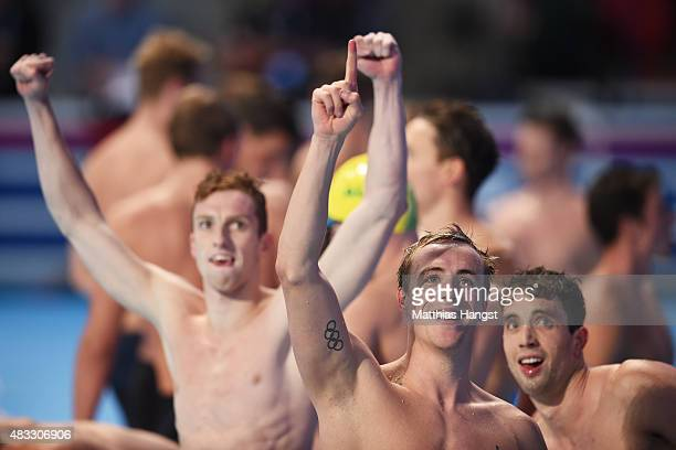 Daniel Wallace Robert Renwick and Calum Jarvis of Great Britain react after winning the gold medal in the Men's 4x200m Freestyle Relay final on day...