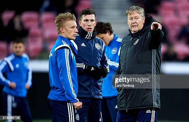 Daniel Wass and Pierre Emile Hojbjerg speaks to Age Hareide head coach of Denmark during the Denmark training session at MCH Arena on March 22 2016...
