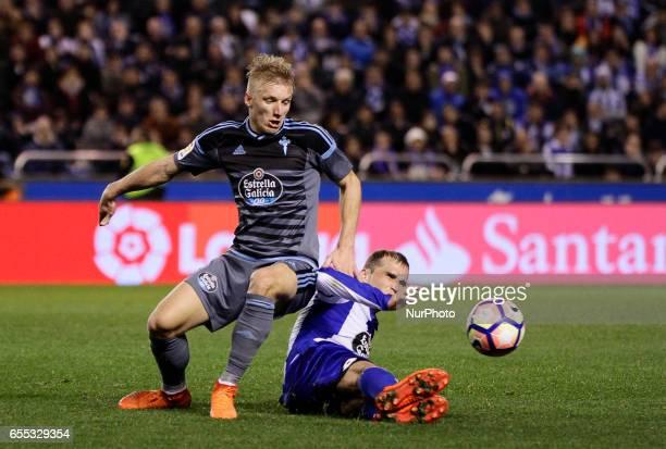 Daniel Wass midfielder of Celta de Vigo battles for the ball with Alex Bergantiños midfielder of Deportivo de La Coruña during the La Liga Santander...