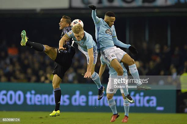 Daniel Wass of Celta de Vigo competes for the ball with Danilo of Real Madrid during the Copa del Rey quarterfinal second leg match between Real Club...