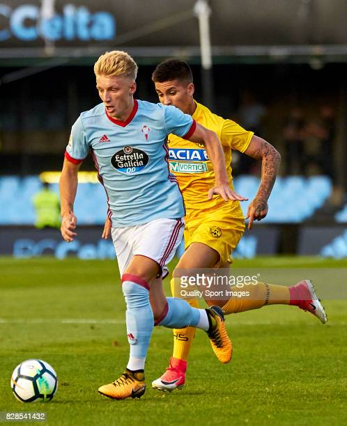 Daniel Wass of Celta de Vigo is challeged by Nicolas Ruscio Garmendia of Udinese Calcio during the Pre Season Friendly match between Celta de Vigo...