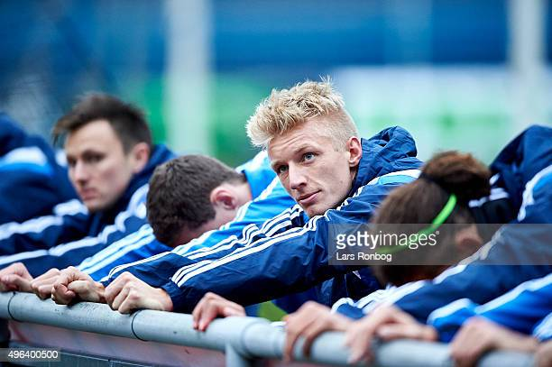 Daniel Wass stretches out during the Denmark Training Session at Helsingor Stadion on November 9 2015 in Helsingor Denmark