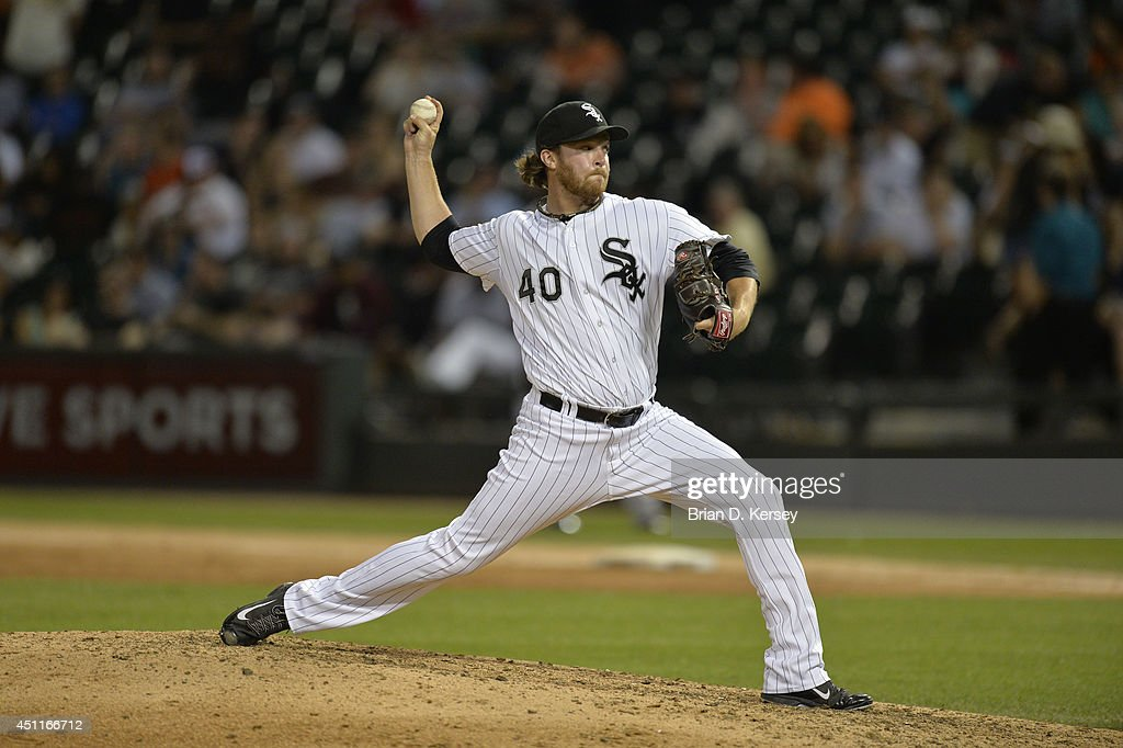 Daniel Webb #40 of the Chicago White Sox delivers a pitch during the ninth inning against the San Francisco Giants at U.S. Cellular Field on June 17, 2014 in Chicago, Illinois. The White Sox defeated the Giants 8-2.