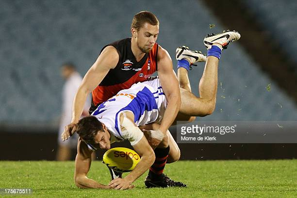 Daniel Webb of West Adelaide tackles Aidan Tropiano of East Fremantle during the Foxtel Cup Grand Final between West Adelaide and East Fremantle at...