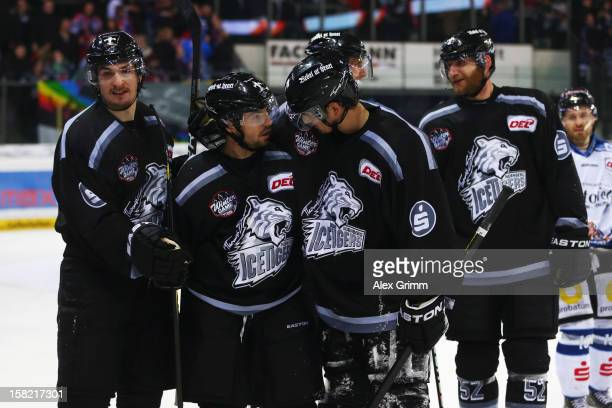 Daniel Weiss of Ice Tigers celebrates his team's fourth goal with team mates during the DEL match between Thomas Sabo Ice Tigers and Straubing Tigers...