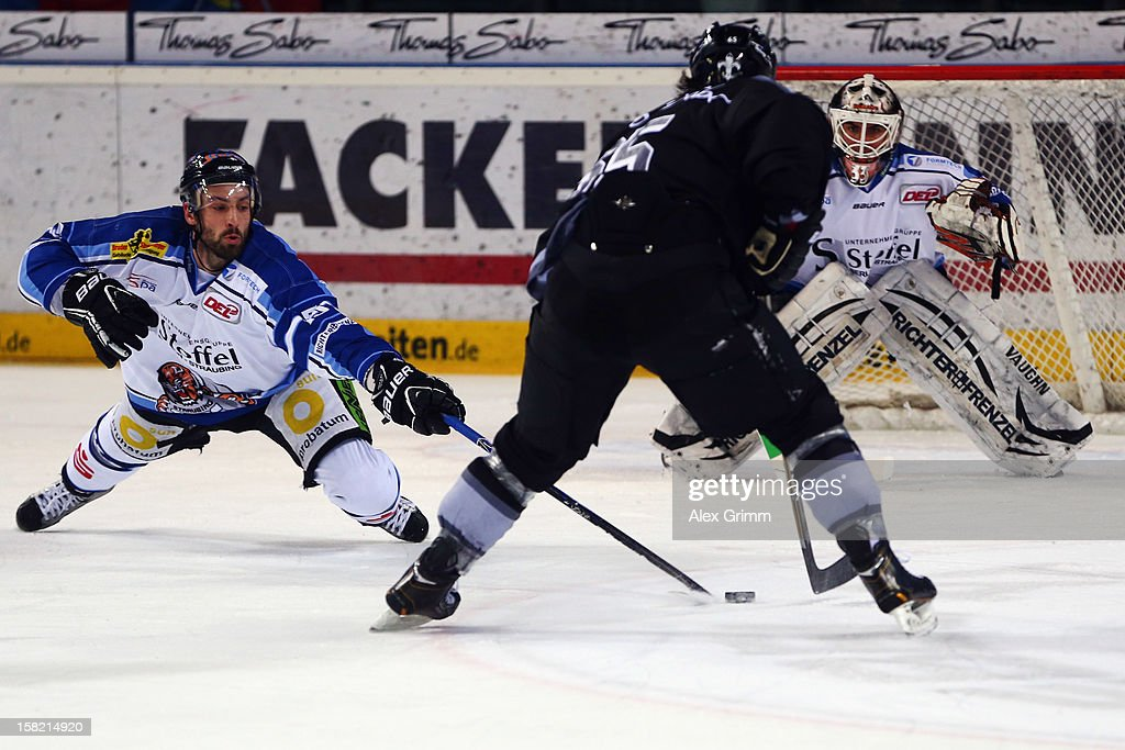 Daniel Weiss (R) of Ice Tigers is challenged by Daniel Sparre of Straubing during the DEL match between Thomas Sabo Ice Tigers and Straubing Tigers at Arena Nuernberger Versicherung on December 11, 2012 in Nuremberg, Germany.