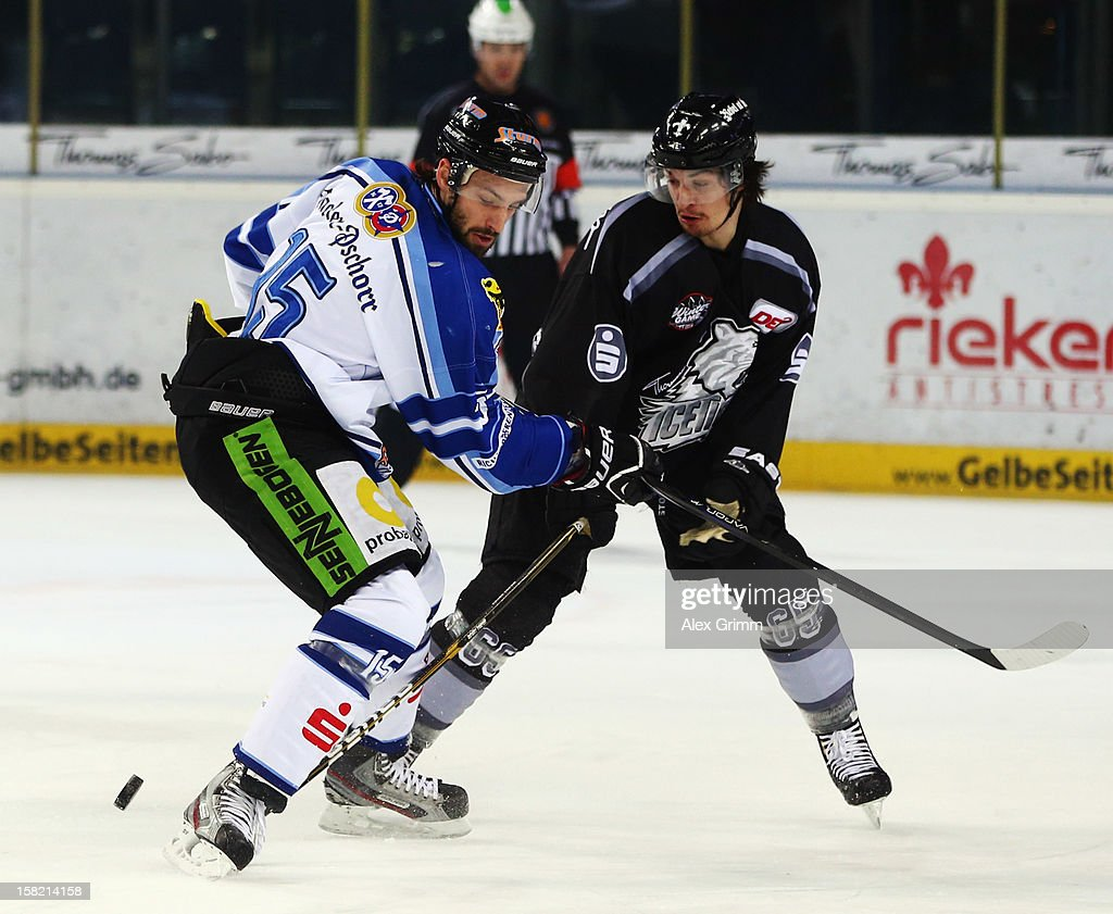 Daniel Weiss (R) of Ice Tigers is challenged by Grant Lewis of Straubing during the DEL match between Thomas Sabo Ice Tigers and Straubing Tigers at Arena Nuernberger Versicherung on December 11, 2012 in Nuremberg, Germany.