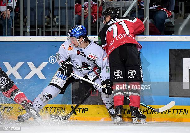 Daniel Weiss of the Augsburger Panther and Andreas Falk of the Koelner Haie during the DEL game between Koelner Haie and the Augsburger Panther on...