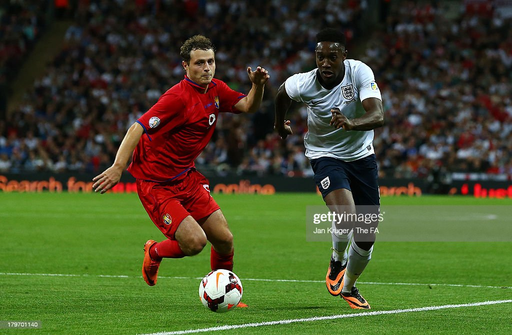 Daniel Welbeck of England (R) and Alexsandru Antoniuc of Moldova in action during the FIFA 2014 World Cup Qualifying Group H match between England and Moldova at Wembley Stadium on September 6, 2013 in London, England.