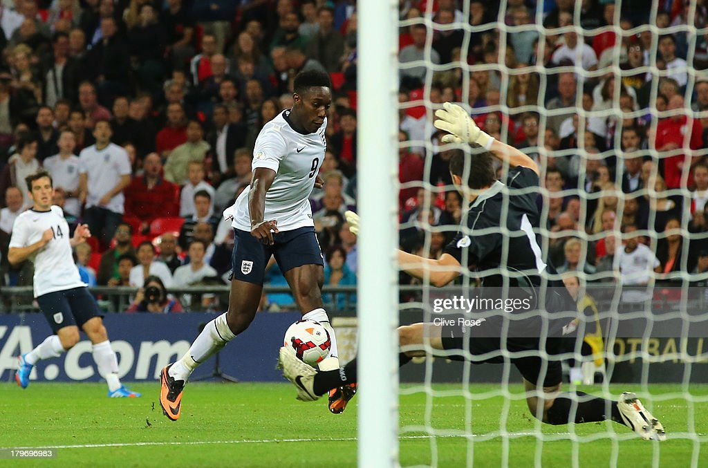 Daniel Welbeck of England scores their fourth goal during the FIFA 2014 World Cup Qualifying Group H match between England and Moldova at Wembley Stadium on September 6, 2013 in London, England.