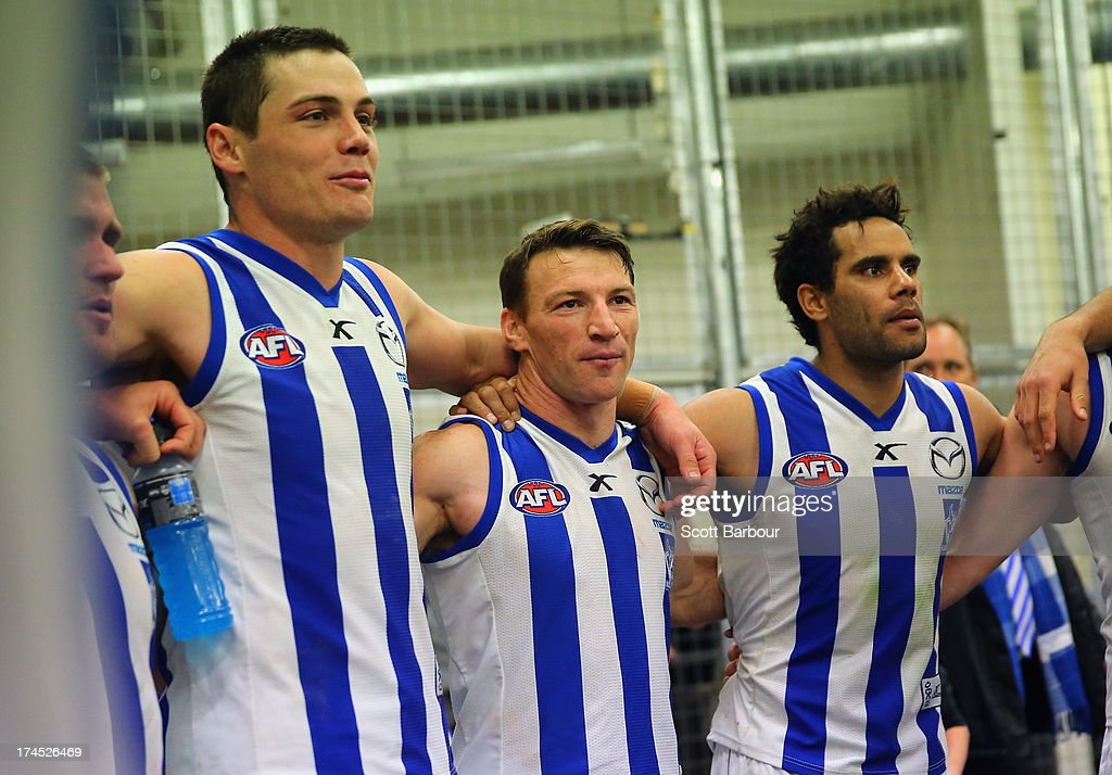 Daniel Wells and Brent Harvey of the Kangaroos sing the team song after winning the round 18 AFL match between the Melbourne Demons and the North Melbourne Kangaroos at Etihad Stadium on July 27, 2013 in Melbourne, Australia.