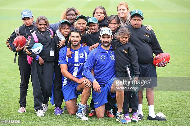 Daniel Wells and Lindsay Thomas pose with kids from Tjuntjuntjara Remote Community School one of the most remote places in Australia during a North...
