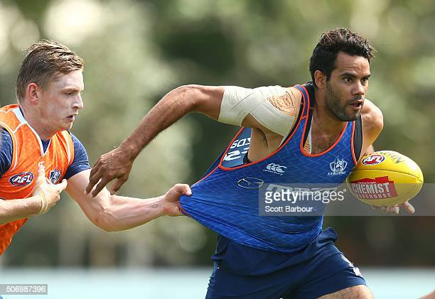 Daniel Wells is tackled by Jack Ziebell during a North Melbourne Kangaroos AFL training session at Arden Street Ground on January 27 2016 in...