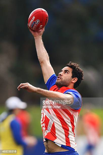 Daniel Wells marks the ball during a North Melbourne Kangaroos AFL training session at Arden Street Ground on August 6 2014 in Melbourne Australia
