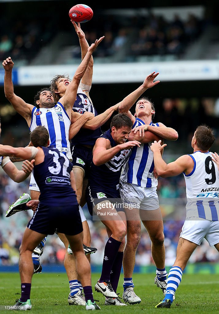 Daniel Wells of the Kangaroos and Nathan Fyfe of the Dockers contest the ruck during the round 13 AFL match between the Fremantle Dockers and the North Melbourne Kangaroos at Patersons Stadium on June 23, 2013 in Perth, Australia.