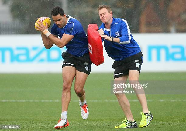 Daniel Wells of the Kangaroos bumps the bag during a North Melbourne Kangaroos AFL media session at Arden Street Ground on September 21 2015 in...