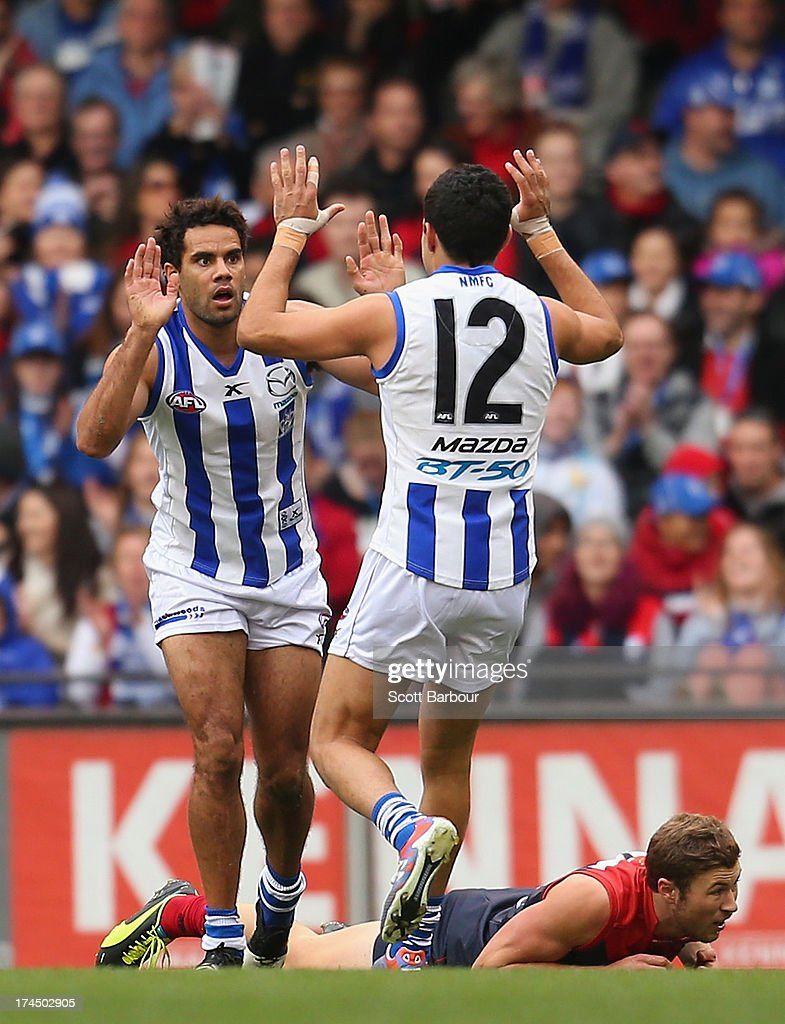 Daniel Wells of the Kangaroos celebrates after kicking a goal during the round 18 AFL match between the Melbourne Demons and the North Melbourne Kangaroos at Etihad Stadium on July 27, 2013 in Melbourne, Australia.