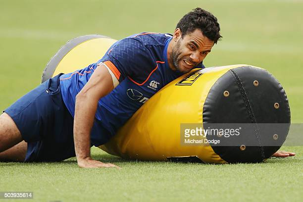 Daniel Wells of the Kangaroos crunches a tackle bag during a North Melbourne Kangaroos AFL preseason training session at Arden Street Ground on...