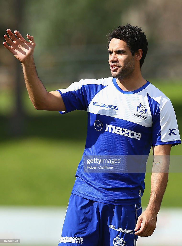 Daniel Wells of the Kangaroos gestures during a training session at Aegis Park on August 29, 2012 in Melbourne, Australia.
